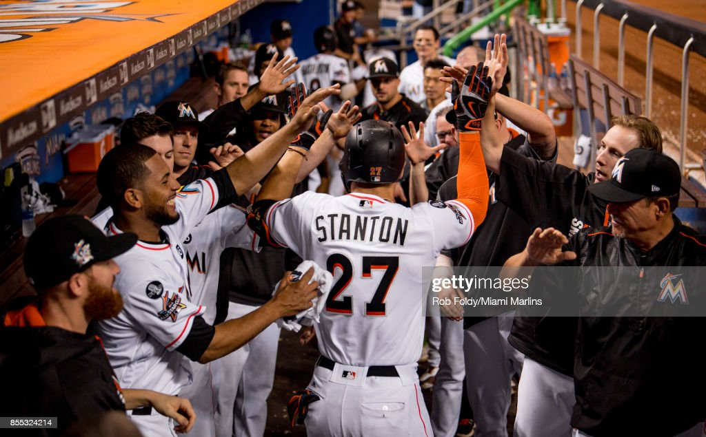 Giancarlo Stanton #27 of the Miami Marlins celebrates in the dugout after hitting his fifty-ninth home run of the season during the eighth inning of the game against the Atlanta Braves at Marlins Park on September 28, 2017 in Miami, Florida.