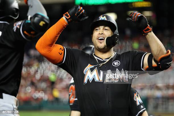 Giancarlo Stanton of the Miami Marlins celebrates with Dee Gordon after hitting a three run home run against the Washington Nationals in the fifth...