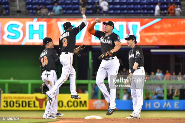 Giancarlo Stanton of the Miami Marlins celebrates with Dee Gordon after they defeated the Cincinnati Reds at Marlins Park on July 29 2017 in Miami...