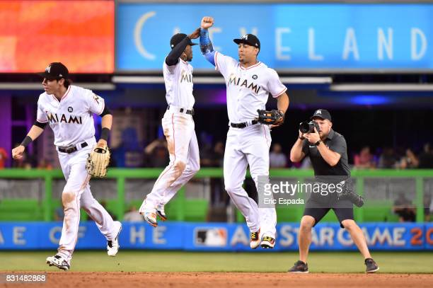 Giancarlo Stanton of the Miami Marlins celebrates with Dee Gordon after defeating the San Francisco Giants at Marlins Park on August 14 2017 in Miami...