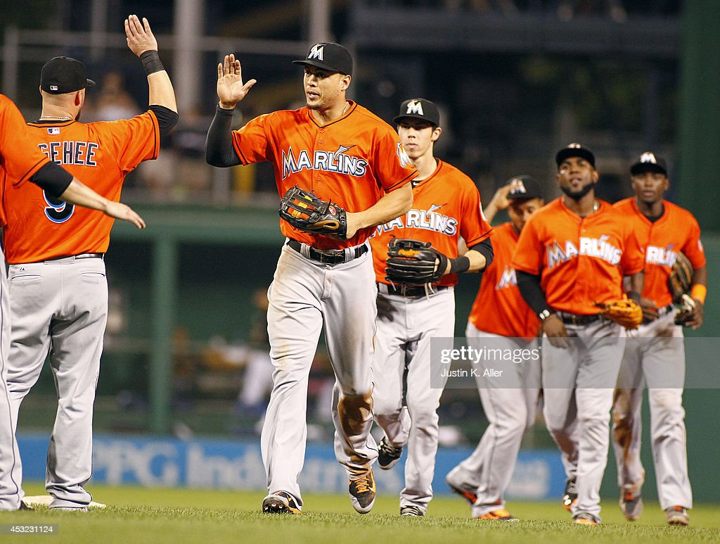 Giancarlo Stanton of the Miami Marlins celebrates with teammates after defeating the Pittsburgh Pirates 63 at PNC Park on August 5 2014 in Pittsburgh...