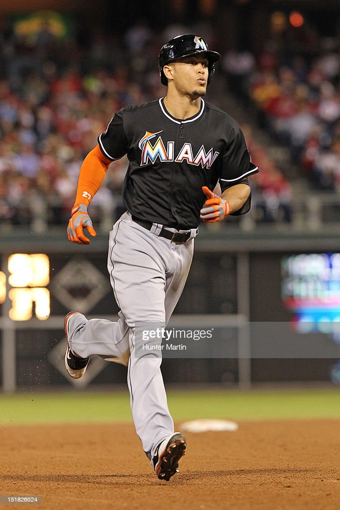 <a gi-track='captionPersonalityLinkClicked' href=/galleries/search?phrase=Giancarlo+Stanton&family=editorial&specificpeople=8983978 ng-click='$event.stopPropagation()'>Giancarlo Stanton</a> #27 of the Miami Marlins circles the bases after hitting a home run during a game against the Philadelphia Phillies at Citizens Bank Park on September 11, 2012 in Philadelphia, Pennsylvania.