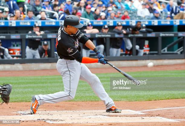 Giancarlo Stanton of the Miami Marlins connects on a first inning three run home run against the New York Mets at Citi Field on May 7 2017 in the...