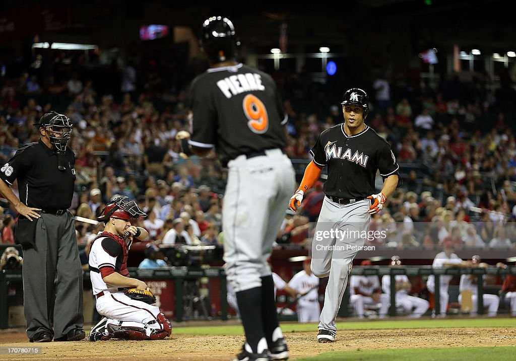<a gi-track='captionPersonalityLinkClicked' href=/galleries/search?phrase=Giancarlo+Stanton&family=editorial&specificpeople=8983978 ng-click='$event.stopPropagation()'>Giancarlo Stanton</a> #27 of the Miami Marlins crosses home plate after hitting a two-run home run against the Arizona Diamondbacks during the sixth inning of the MLB game at Chase Field on June 17, 2013 in Phoenix, Arizona.