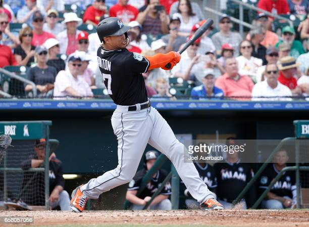 Giancarlo Stanton of the Miami Marlins doubles against the St Louis Cardinals in the xfourth inning during a spring training game at Roger Dean...