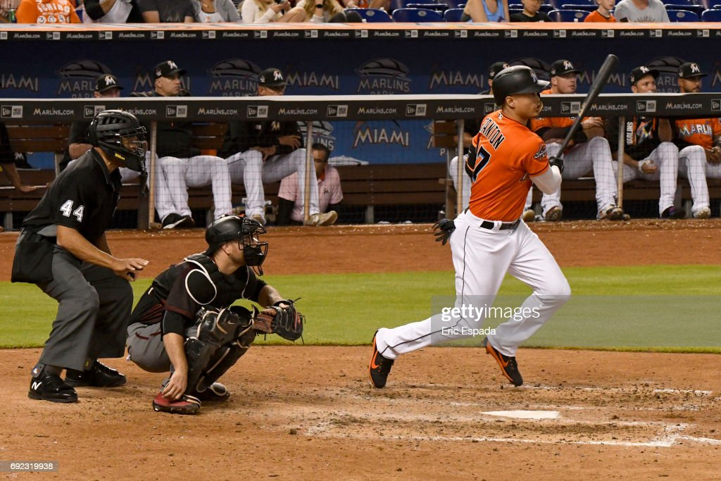Giancarlo Stanton #27 of the Miami Marlins doubles in the fifth inning against the Arizona Diamondbacks at Marlins Park on June 4, 2017 in Miami, Florida.