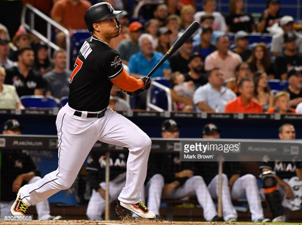 Giancarlo Stanton of the Miami Marlins doubles in the first inning during the game between the Miami Marlins and the Colorado Rockies at Marlins Park...
