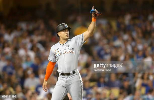 Giancarlo Stanton of the Miami Marlins gestures after scoring a run in the third inning against the Los Angeles Dodgers at Dodger Stadium on May 20...