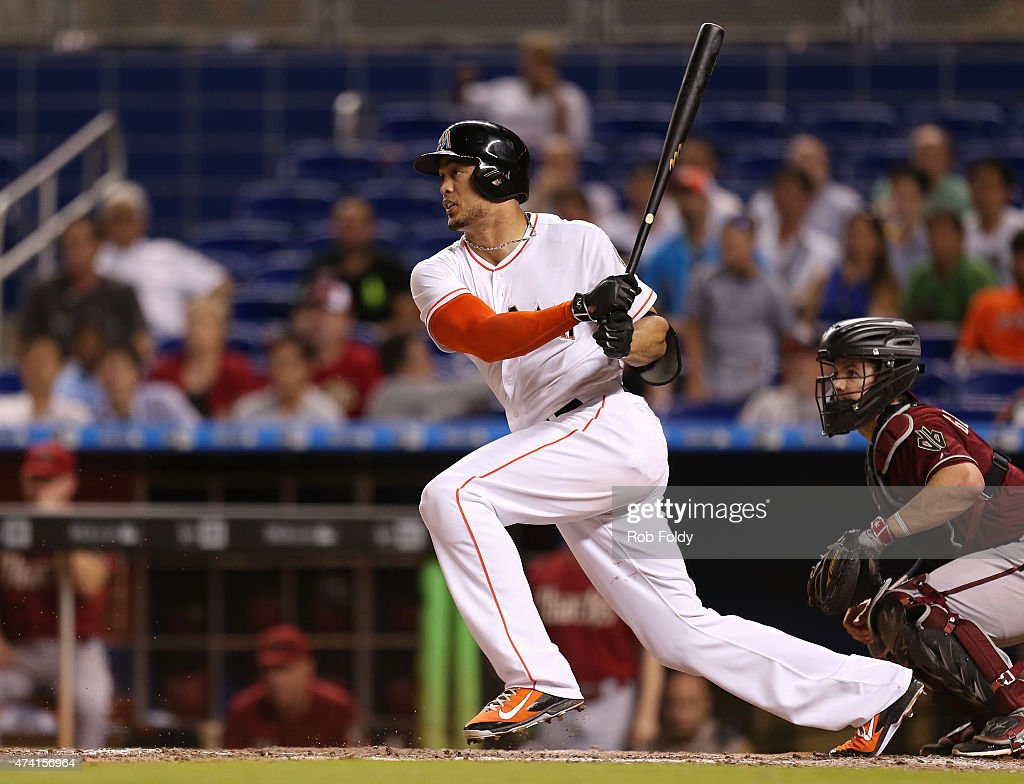 Giancarlo Stanton #27 of the Miami Marlins grounds into a double play during the ninth inning of the game against the Arizona Diamondbacks at Marlins Park on May 20, 2015 in Miami, Florida.