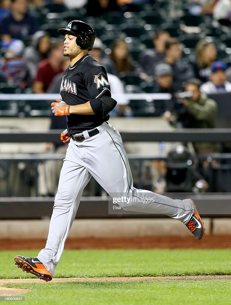 <a gi-track='captionPersonalityLinkClicked' href=/galleries/search?phrase=Giancarlo+Stanton&family=editorial&specificpeople=8983978 ng-click='$event.stopPropagation()'>Giancarlo Stanton</a> #27 of the Miami Marlins heads for home after he hit a solo home run in the seventh inning against the New York Mets on August 13, 2013 at Citi Field in the Flushing neighborhood of the Queens borough of New York City.