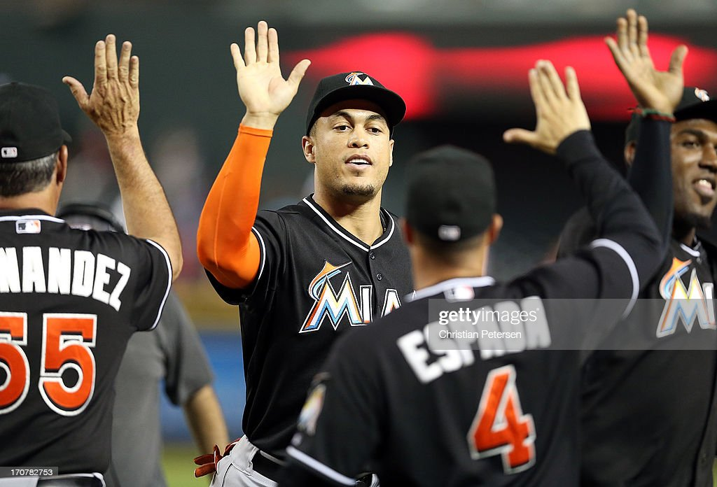 <a gi-track='captionPersonalityLinkClicked' href=/galleries/search?phrase=Giancarlo+Stanton&family=editorial&specificpeople=8983978 ng-click='$event.stopPropagation()'>Giancarlo Stanton</a> #27 of the Miami Marlins high-fives teamamtes after defeating the Arizona Diamondbacks in the MLB game at Chase Field on June 17, 2013 in Phoenix, Arizona. The Marlins defeated the Diamondbacks 3-2.
