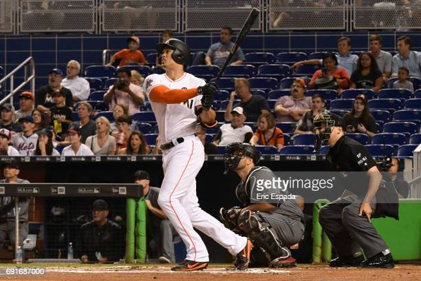 Giancarlo Stanton of the Miami Marlins hits a double in the first inning against the Arizona Diamondbacks at Marlins Park on June 2 2017 in Miami...