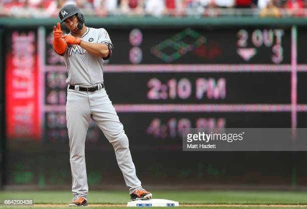 Giancarlo Stanton of the Miami Marlins hits a double onerun RBI against the Washington Nationals in the fourth inning of the opening day game at...