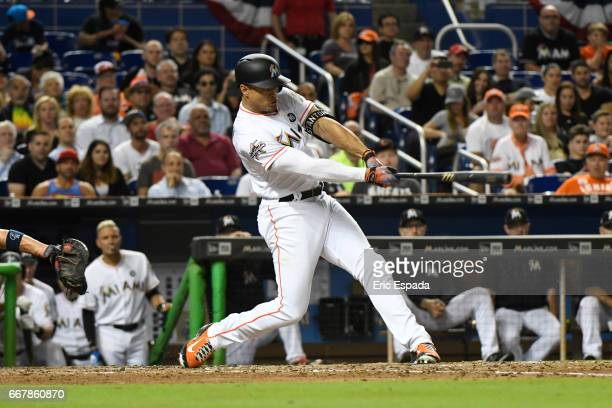Giancarlo Stanton of the Miami Marlins hits a homerun in the 5th inning against the Atlanta Braves at Marlins Park on April 12 2017 in Miami Florida