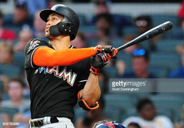 Giancarlo Stanton of the Miami Marlins hits a sixth inning solo home run against the Atlanta Braves at SunTrust Park on August 5 2017 in Atlanta...