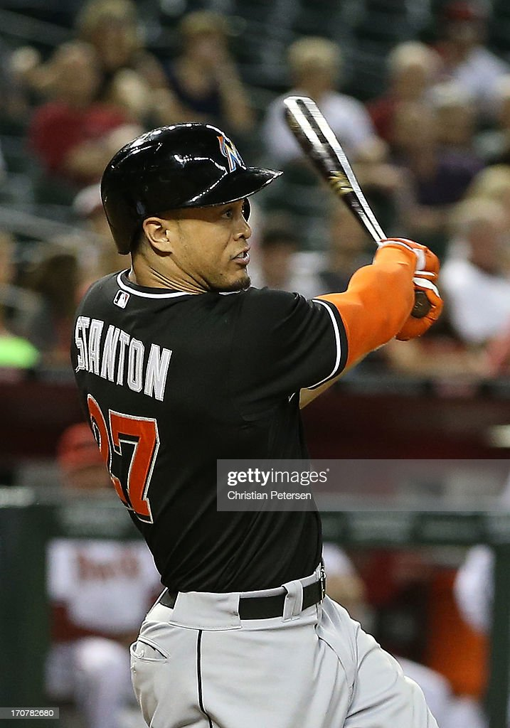 <a gi-track='captionPersonalityLinkClicked' href=/galleries/search?phrase=Giancarlo+Stanton&family=editorial&specificpeople=8983978 ng-click='$event.stopPropagation()'>Giancarlo Stanton</a> #27 of the Miami Marlins hits a solo home run against the Arizona Diamondbacks during the ninth inning of the MLB game at Chase Field on June 17, 2013 in Phoenix, Arizona. The Marlins defeated the Diamondbacks 3-2.