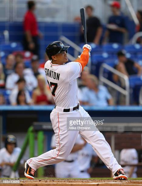 Giancarlo Stanton of the Miami Marlins hits a solo home run during a game against the Milwaukee Brewers at Marlins Park on May 23 2014 in Miami...