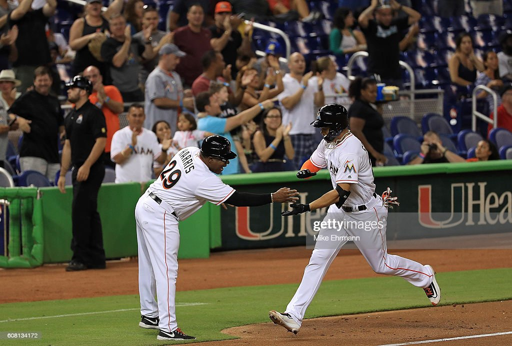 Giancarlo Stanton #27 of the Miami Marlins hits a solo home run during a game against the Washington Nationals at Marlins Park on September 19, 2016 in Miami, Florida.
