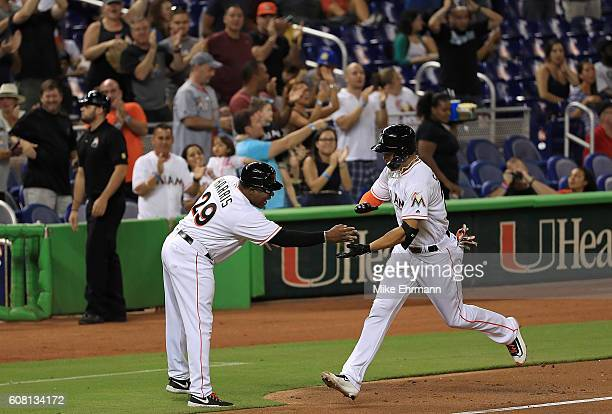 Giancarlo Stanton of the Miami Marlins hits a solo home run during a game against the Washington Nationals at Marlins Park on September 19 2016 in...