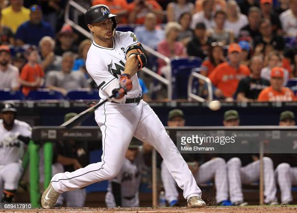 Giancarlo Stanton of the Miami Marlins hits a solo home run in the first inning during a game against the Los Angeles Angels at Marlins Park on May...