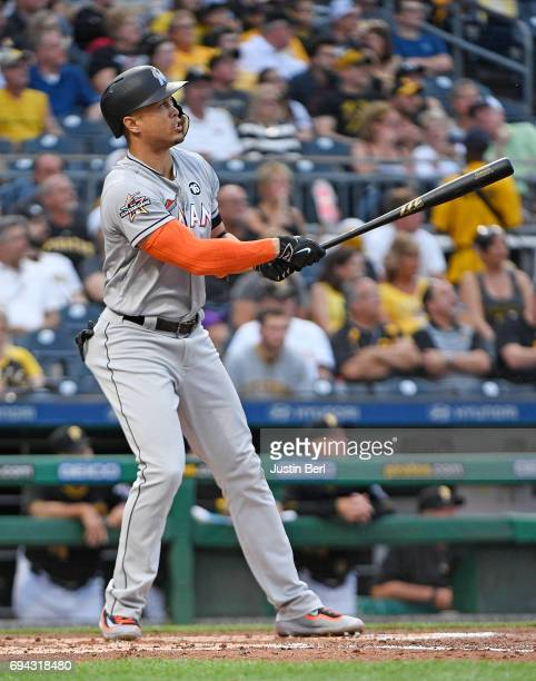 Giancarlo Stanton of the Miami Marlins hits a solo home run in the third inning during the game against the Pittsburgh Pirates at PNC Park on June 9...