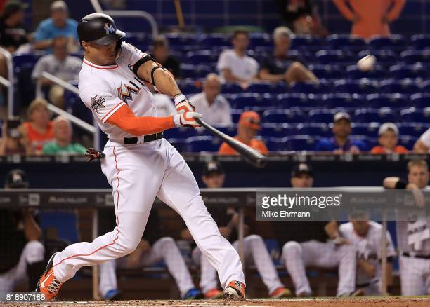 Giancarlo Stanton of the Miami Marlins hits a solo home run in the first inning during a game against the Philadelphia Phillies at Marlins Park on...