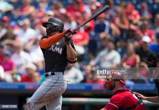 Giancarlo Stanton of the Miami Marlins hits a solo home run in the top of the third inning against the Philadelphia Phillies at Citizens Bank Park on...