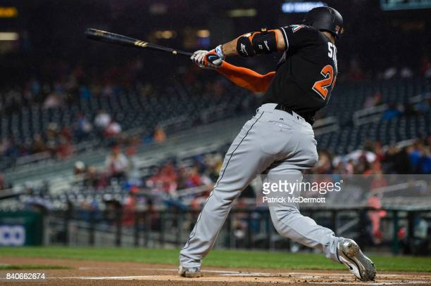 Giancarlo Stanton of the Miami Marlins hits a solo home run in the first inning against the Washington Nationals at Nationals Park on August 29 2017...