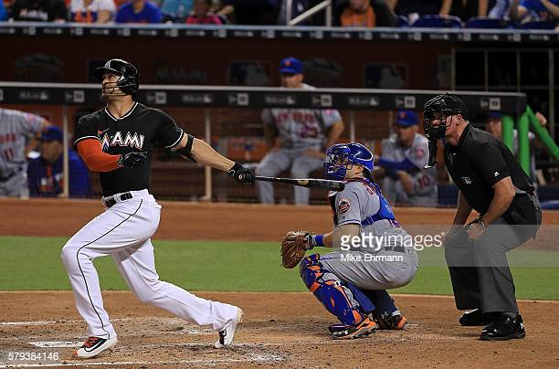 Giancarlo Stanton of the Miami Marlins hits a two run home run during a game against the New York Mets at Marlins Park on July 23 2016 in Miami...