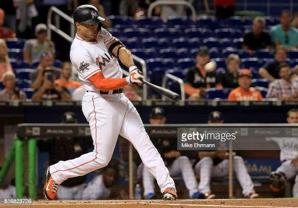 Giancarlo Stanton of the Miami Marlins hits a two run home run in the first inning during a game against the Philadelphia Phillies at Marlins Park on...