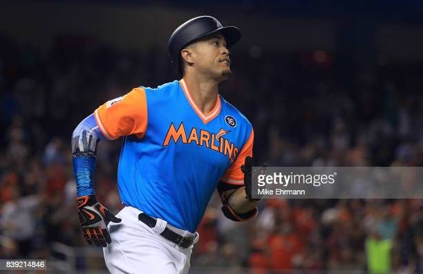 Giancarlo Stanton of the Miami Marlins hits a two run home run in the first inning during a game against the San Diego Padres at Marlins Park on...