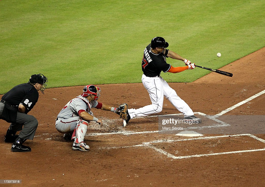 <a gi-track='captionPersonalityLinkClicked' href=/galleries/search?phrase=Giancarlo+Stanton&family=editorial&specificpeople=8983978 ng-click='$event.stopPropagation()'>Giancarlo Stanton</a> #27 of the Miami Marlins hits a two-run home run against the Washington Nationals during the second inning at Marlins Park on July 12, 2013 in Miami, Florida.