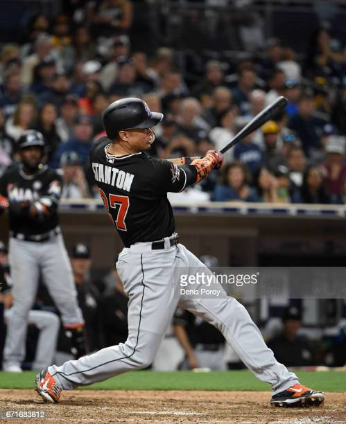 Giancarlo Stanton of the Miami Marlins hits a tworun home run during the eleventh inning of a baseball game against the San Diego Padres at PETCO...