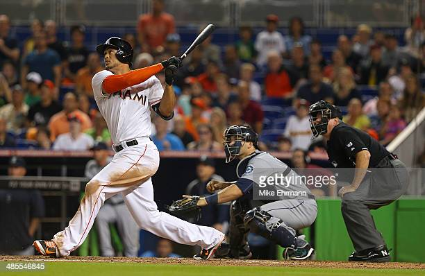 Giancarlo Stanton of the Miami Marlins hits a walk off grand slam during a game against the Seattle Mariners at Marlins Park on April 18 2014 in...