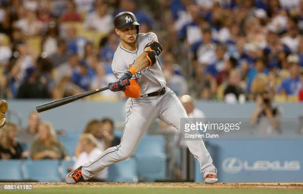 Giancarlo Stanton of the Miami Marlins hits an RBI double in the third inning against the Los Angeles Dodgers at Dodger Stadium on May 20 2017 in Los...