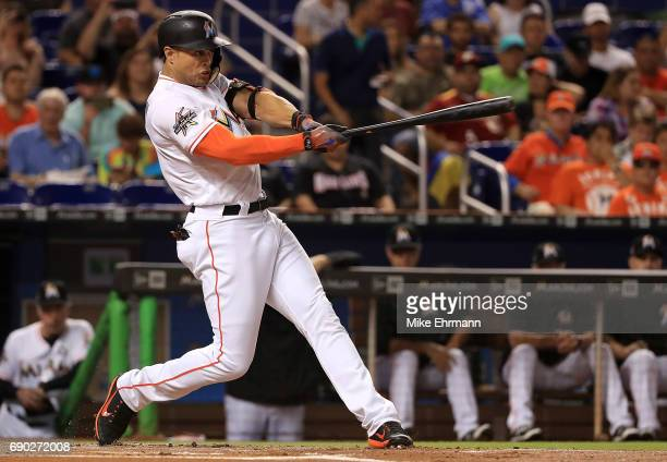 Giancarlo Stanton of the Miami Marlins hits during a game against the Philadelphia Phillies at Marlins Park on May 30 2017 in Miami Florida