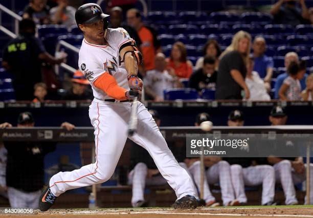 Giancarlo Stanton of the Miami Marlins hits during a game against the Washington Nationals at Marlins Park on September 5 2017 in Miami Florida