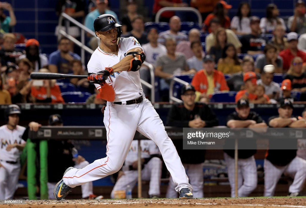 Giancarlo Stanton #27 of the Miami Marlins hits during a game against the Atlanta Braves at Marlins Park on September 30, 2017 in Miami, Florida.