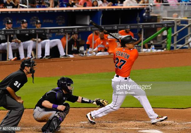 Giancarlo Stanton of the Miami Marlins hits his 42nd homerun in the third inning during the game between the Miami Marlins and the Colorado Rockies...