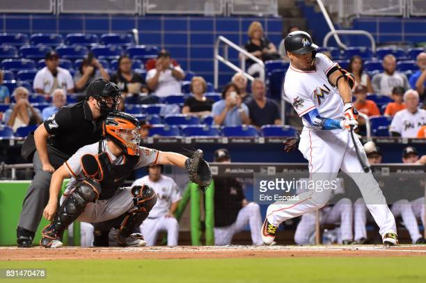 Giancarlo Stanton of the Miami Marlins hits his 43rd homer of the season in the first inning against the San Francisco Giants at Marlins Park on...