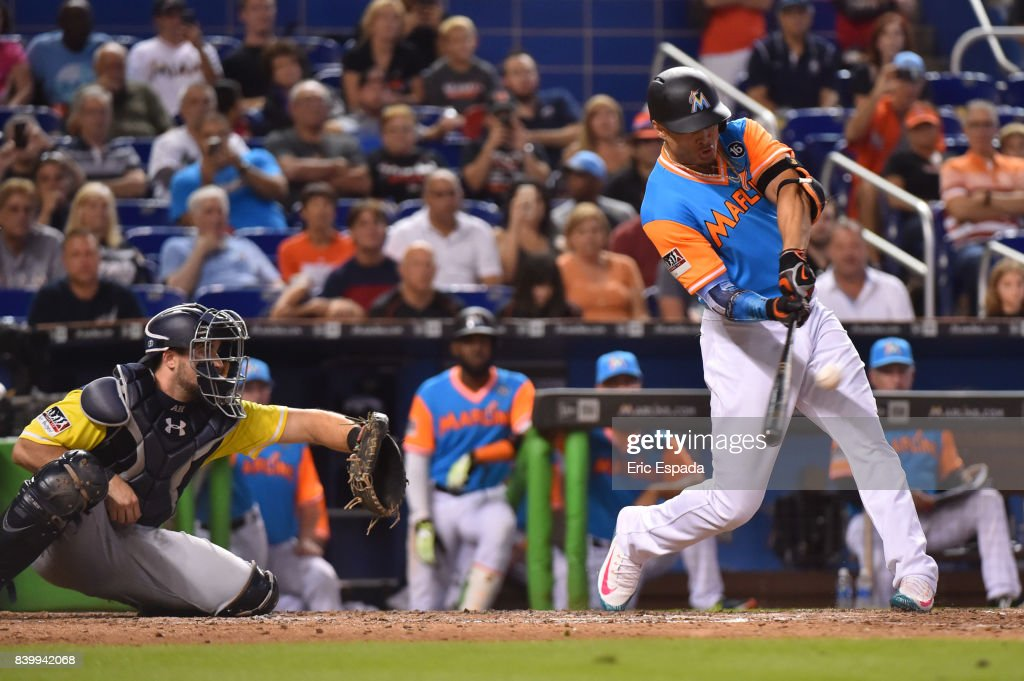 Giancarlo Stanton #27 of the Miami Marlins hits his 50th home run of the season in the eighth inning against the San Diego Padres at Marlins Park on August 27, 2017 in Miami, Florida.