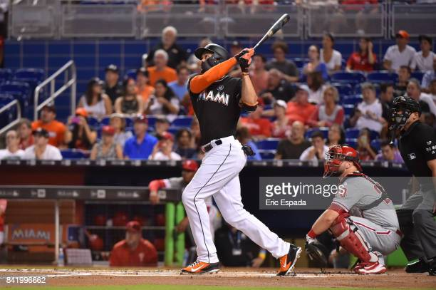 Giancarlo Stanton of the Miami Marlins hits his 52nd home run of the season during the first season against the Philadelphia Phillies at Marlins Park...