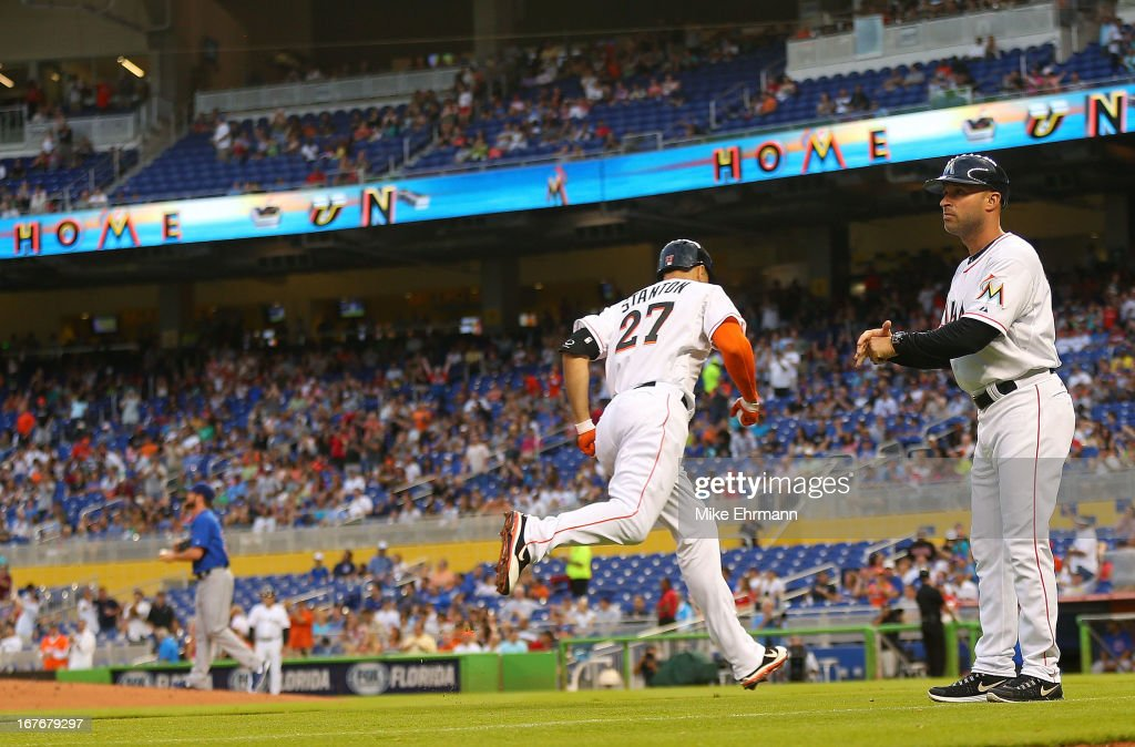 Giancarlo Stanton #27 of the Miami Marlins hits his first home run of the season during a game against the Chicago Cubs at Marlins Park on April 27, 2013 in Miami, Florida.
