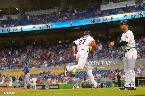 Giancarlo Stanton of the Miami Marlins hits his first home run of the season during a game against the Chicago Cubs at Marlins Park on April 27 2013...