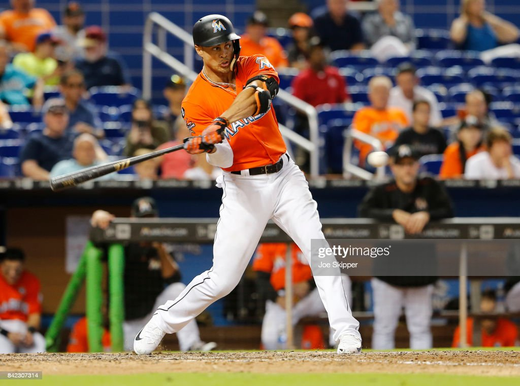 Giancarlo Stanton #27 of the Miami Marlins hits in the 12th inning before being walked during play against the Philadelphia Phillies at Marlins Park on September 3, 2017 in Miami, Florida.