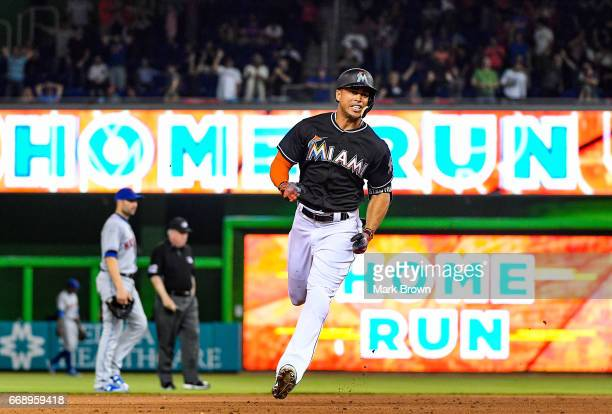 Giancarlo Stanton of the Miami Marlins hits the go ahead homerun in the eighth inning during the game between the Miami Marlins and the New York Mets...