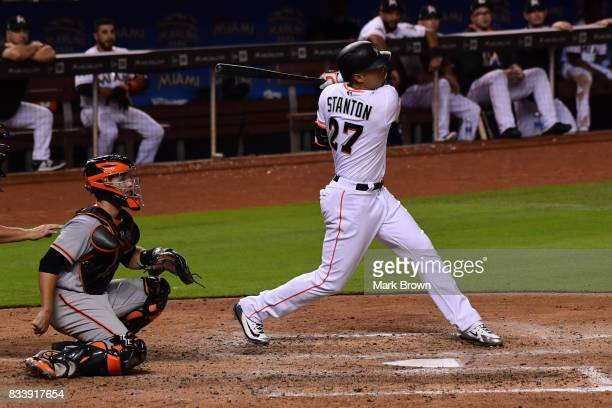 Giancarlo Stanton of the Miami Marlins in action during the game between the Miami Marlins and the San Francisco Giants at Marlins Park on August 15...