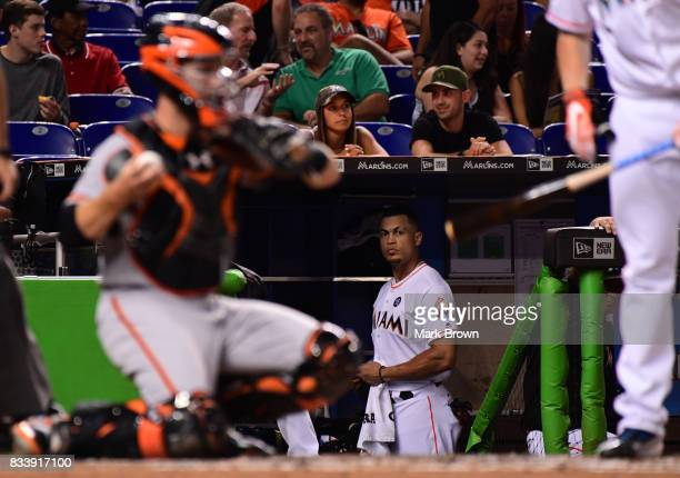 Giancarlo Stanton of the Miami Marlins in the dugout during the game between the Miami Marlins and the San Francisco Giants at Marlins Park on August...