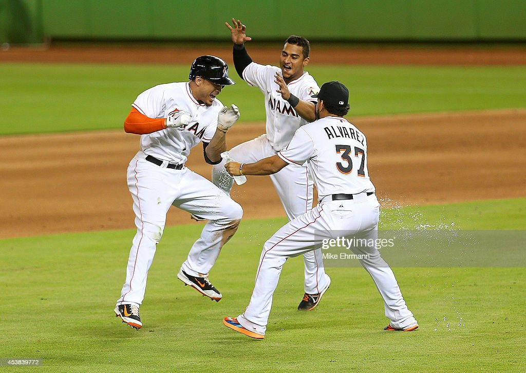<a gi-track='captionPersonalityLinkClicked' href=/galleries/search?phrase=Giancarlo+Stanton&family=editorial&specificpeople=8983978 ng-click='$event.stopPropagation()'>Giancarlo Stanton</a> #27 of the Miami Marlins is congratulated after hitting a walk off single to beat the Texas Rangers 4-3 at Marlins Park on August 19, 2014 in Miami, Florida.