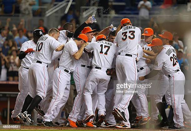 Giancarlo Stanton of the Miami Marlins is congratulated after hitting a walk off grand slam during a game against the Seattle Mariners at Marlins...